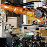 KUKA industrial robots for the transportation of parts within an inspection cell for ABS brake blocks